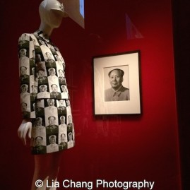"""Vivienne Tam (American, born Guangzhou) """"Mao Suit,"""" spring/summer 1995, White and black polyester jacquard, Courtesy of Vivienne Tam, Unidentified artist (Chinese, active 1960s) Chin Shilin (Chinese, born 1930) """"Chairman Mao,"""" 1964, Gelatin silver print, Twentieth-Century Photography Fund, 2011 (2011.368). Photo by Lia Chang"""