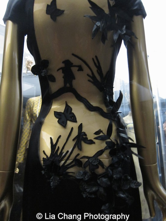 Jean Paul Gaultier (French, born 1952), Evening dress, autumn/winter 2001–2 haute couture Black lacquered silk satin and nude silk tulle embroidered with black synthetic thread Courtesy of Jean Paul Gaultier. Photo by Lia Chang