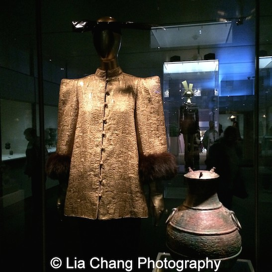 An ensemble by Yves Saint Laurent from 1977–78; Chinese Ritual Wine Container (Hu) Eastern Zhou dynasty, Spring and Autumn period (770–476 B.C.), early 5th century B.C. Bronze inlaid with copper.