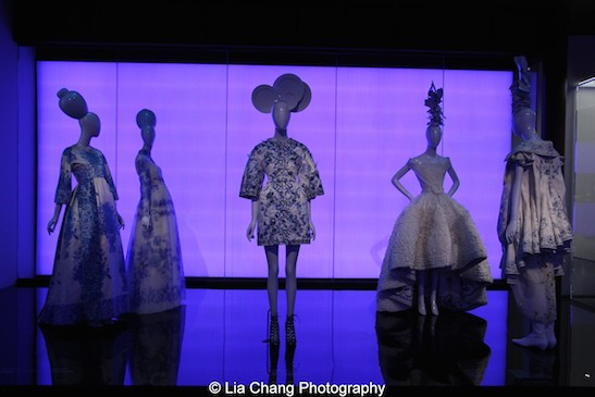 Gallery view, Chinese Galleries, Frances Young Tang Gallery, Blue and White Porcelain. (L-R) Valentino Garavani (Italian, born 1932), Evening gown, autumn/winter 1968–69, haute couture White and blue-printed silk satin, Courtesy of Valentino S.p.A.; Valentino S.p.A. (Italian, founded 1959) Dress, autumn/winter 2013, White and blue-printed silk organza, Gift of Valentino S.p.A., 2015 (2015.491.1); Giambattista Valli (Italian, born 1966), Coat, autumn/winter 2013 haute couture, White and blue-printed silk faille, embroidered with navy, blue, and white silk thread, clear synthetic sequins, crystals, and appliqué of blue and white silk organza, Courtesy of Giambattista Valli; Courtesy of Christian Dior Couture, House of Dior (French, founded 1947), John Galliano (British, born Gibraltar, 1960), Evening gown, spring/summer 2009 haute couture, White silk organza and lace, and white silk satin embroidered with blue silk thread, Courtesy of Christian Dior Couture; House of Dior (French, founded 1947), John Galliano (British, born Gibraltar, 1960), Ensemble, spring/summer 2005 haute couture, Coat of white silk jacquard embroidered with blue and white silk thread; dress of white silk organza embroidered with crystals, gold and green silk, and silver metallic thread, Courtesy of Christian Dior Couture. Photo by Lia Chang