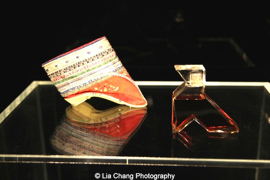 Chinese Shoe, 1800–1943, Red silk satin embroidered with polychrome silk thread. One of the more unusual flacons was created by the Callot Soeurs for the perfume La Fille du Roi de Chine. Shaped after a ''lotus shoe'' for a bound foot, it explicitly associated perfume, in Western eyes, with the exotic practice of foot-binding.