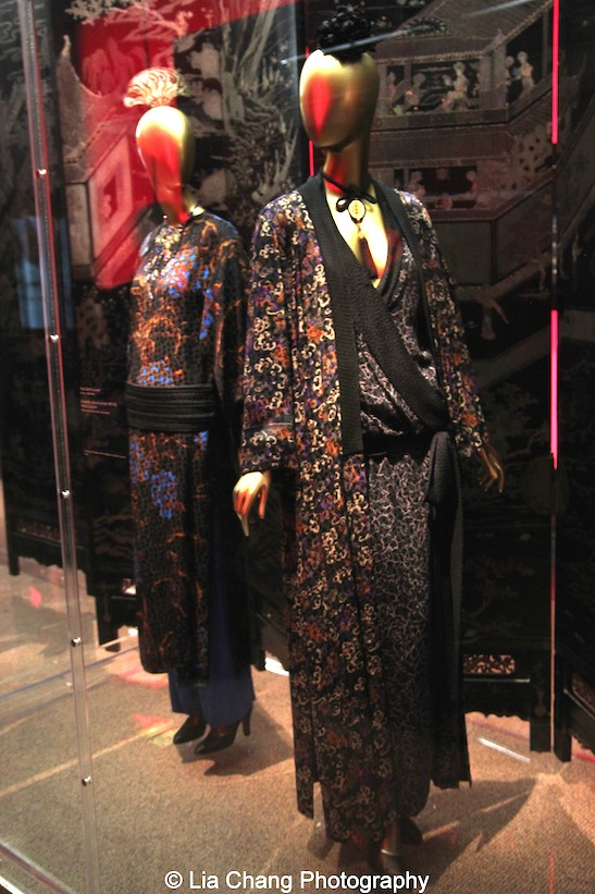 Yves Saint Laurent haute couture ensemble from 1977–78 of Polychrome printed black silk damask.