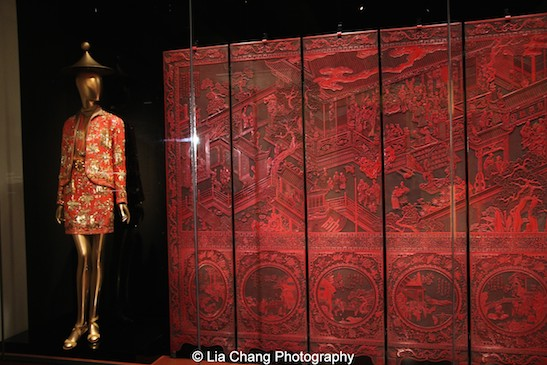 A 1777 screen, center, for a birthday celebration for Gen. Guo Ziyi, made of carved red lacquer. At left is an haute couture ensemble by Valentino from 1990-91.