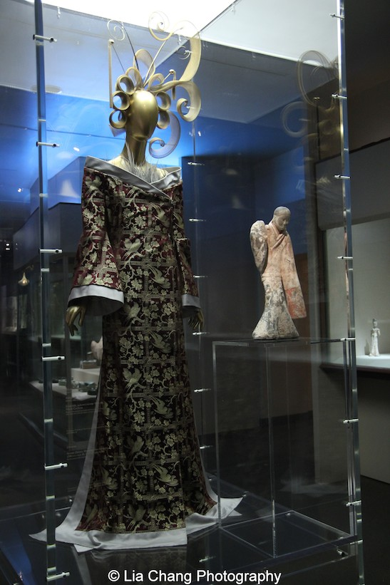 An haute couture dress by Alexander McQueen for the House of Givenchy from 1997 of red-purple and gold silk brocade; Chinese Female Dancer, Western Han dynasty (206 B.C.–A.D. 9), 2nd century B.C., Earthenware with pigment.