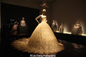 Guo Pei (Chinese, born 1967), Evening gown, spring/summer 2007 haute couture, Gold lamé embroidered with gold and silver silk, metal, and sequins Courtesy of Guo Pei. Photo by Lia Chang