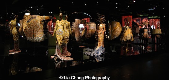 Gallery View Anna Wintour Costume Center, Imperial China. Designs from Yves Saint Laurent by Tom Ford, Laurence Xu, John Galliano for the House of Dior and Dries Van Noten on display with Semiformal Robes for the Qianlong Emperor (1736-95) in the Metropolitan Museum's Costume Institute exhibition