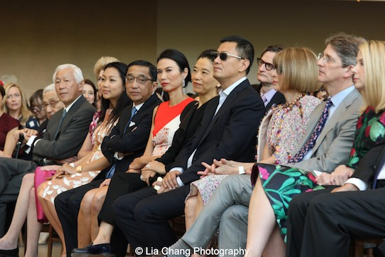 Dr. Henry Kissinger, Oscar Tang, Emily K. Rafferty, Veronica Chou and her father Silas Chou, Wendi Murdoch, Esther and her husband filmmaker Wong Kar-Wai, Vogue editor-in-chief Anna Wintour, Metropolitan Museum of Art Director and CEO Thomas Campbell, and Yahoo CEO Marissa Mayer, listen to remarks during a presentation of speakers at the press preview of the Metropolitan Museum's Costume Institute exhibition