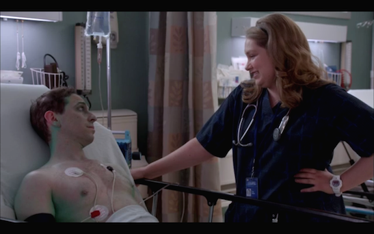 Garth Kravits as Reed, a Statue of Liberty Street performer and Merrit Weaver as Nurse Zoey Barkow, in Showtime's