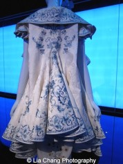 Gallery view, Chinese Galleries, Frances Young Tang Gallery, Blue and White Porcelain. House of Dior (French, founded 1947), John Galliano (British, born Gibraltar, 1960), Ensemble, spring/summer 2005 haute couture, Coat of white silk jacquard embroidered with blue and white silk thread; dress of white silk organza embroidered with crystals, gold and green silk, and silver metallic thread. Courtesy of Christian Dior Couture. Photo by Lia Chang