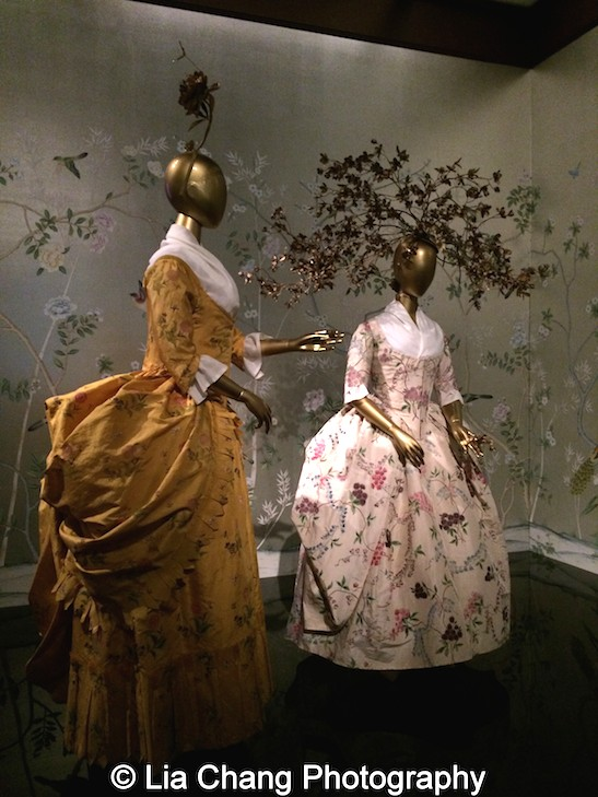 American Robe à la Polonaise from 1780-85 of Yellow silk taffeta hand-painted with polychrome floral motifs; French Robe à la Polonaise, ca. 1780 of White silk taffeta hand-painted with polychrome floral motifs.