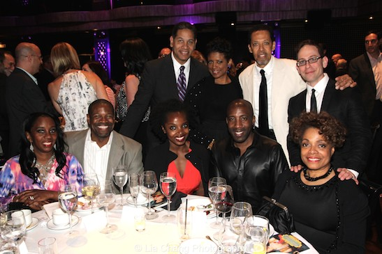 (seated) Selena Evans, Robert Evans, MaameYaa Boafo, Jeremiah Abiah, Denise Burse Fernandez, (standing) Akwasi Taha, Marva Hicks, Peter Jay Fernandez, Garth Kravits attend The 52nd Street Project's Fancy That Benefit at The Edison Ballroom in New York on May 4, 2015. Photo by Lia Chang