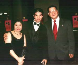 Telly Leung with his parents at the opening party of Flower Drum Song at the Marriott Marquis in New York in October, 2002. Photo by Lia Chang
