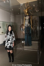 """Fashion Designer Vivienne Tam poses with her """"Kuan Yin"""" dress, Polychrome printed nylon mesh (spring/summer 1997). Photo by Lia Chang"""