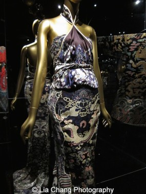 Yves Saint Laurent (French, founded 1961) Tom Ford (American, born 1961) Evening dress, autumn/winter 2004–5 Polychrome printed black silk satin and chiffon Courtesy of Tom Ford Archive Chinese Theatrical costume made during the Reign of the Qianlong Emperor, 1736-95, Black silk satin brocaded with polychrome silk thread. Courtesy of the Palace Museum, Beijing. Photo by Lia Chang