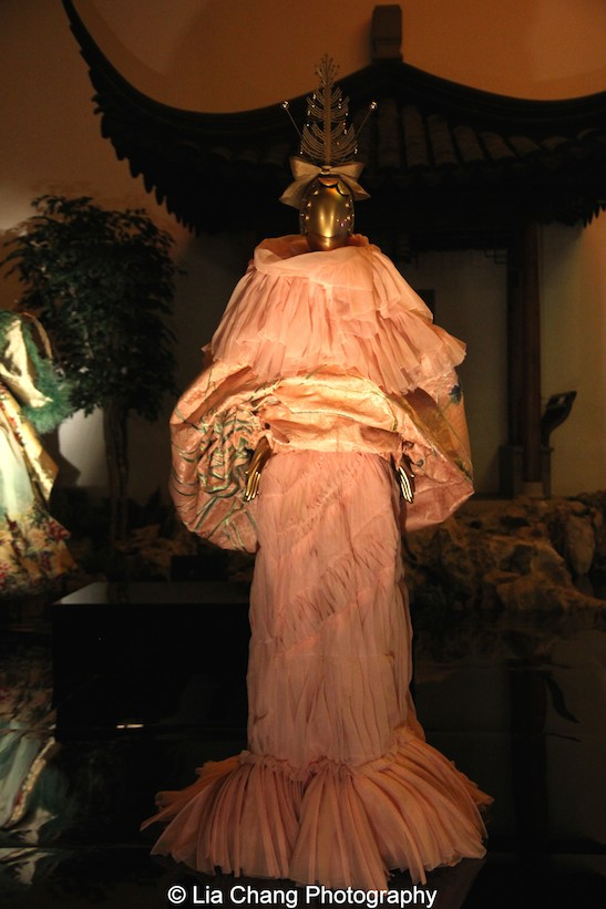 Gallery View of The Astor Court- House of Dior (French, founded 1947)John Galliano (British, born Gibraltar, 1960)Ensemble, spring/summer 2003 haute coutureCoat of pink silk jacquard embroidered with green and blue silk and gold metallic thread; dress of pink silk organza, Courtesy of Christian Dior Couture. Photo by Lia Chang