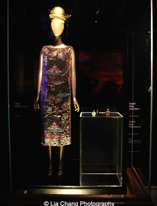A 1920 Jean Patou dress of Black silk chiffon embroidered with polychrome plastic beads.