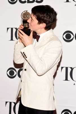 """NEW YORK, NY - JUNE 07: Alex Sharp, winner of the award for Best Performance by an Actor in a Leading Role in a Play for """"The Curious Incident of the Dog in the Night-Time,"""" poses in the press room at the 2015 Tony Awards on June 7, 2015 in New York City. (Photo by Andrew H. Walker/Getty Images for Tony Awards Productions)"""
