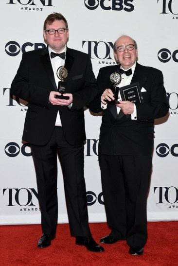 """NEW YORK, NY - JUNE 07: .Christopher Austin (L) and Bill Elliott, winners of the award for Best Orchestrations """"An American in Paris,"""" pose in the press room at the 2015 Tony Awards on June 7, 2015 in New York City. (Photo by Andrew H. Walker/Getty Images for Tony Awards Productions)"""