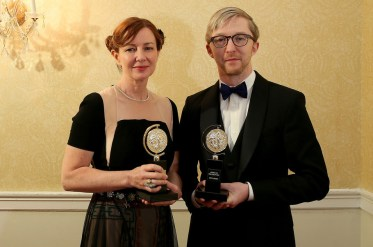 """NEW YORK, NY - JUNE 07: Bunny Christie (L) and Finn Ross, winners of the award for Best Scenic Design of a Play for """"The Curious Incident of the Dog in the Night-Time,"""" pose in the press room at the 2015 Tony Awards on June 7, 2015 in New York City. (Photo by Jemal Countess/Getty Images for Tony Awards Productions)"""