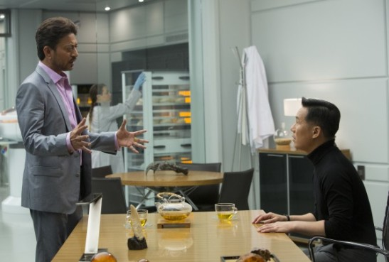 Irrfan Khan as Simon Masrani and BD Wong as Dr. Henry Wu in Jurassic World. © Universal Pictures