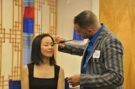 Lia Chang gets the vip treatment from Blue Michael of Blue Michael Cosmetics at the 72 Hour Shootout Launch party at The Korea Society in New York on June 4, 2015. Photo by Lia Chang