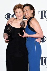 "NEW YORK, NY - JUNE 07: Lisa Kron (L) and Jeanine Tesori, winners of the award for Best Original Score (Music and/or Lyrics) Wrtitten for the Theatre for ""Fun Home,"" pose in the press room at the 2015 Tony Awards on June 7, 2015 in New York City. (Photo by Andrew H. Walker/Getty Images for Tony Awards Productions)"
