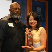 Asian American Film Lab president Jennifer Betit Yen presented silent auction winner Patrick Coker with the Shootout embossed bottle of Johnny Walker donated by Diageo, at the 72 Hour Shootout Launch party at The Korea Society in New York on June 4, 2015. Photo by Lia Chang