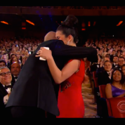 The King and I's Ruthie Ann Miles is hugged by her co-star Ken Watanabe upon winning the Tony Award for Best Featured Actress in a Musical at the 69th Annual Tony Awards at Radio City Music Hall in New York on June 7, 2015.
