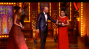The King and I's Ruthie Ann Miles is presented with the Tony Award for Best Featured Actress in a Musical by Sutton Foster and Corey Stoll at the 69th Annual Tony Awards at Radio City Music Hall in New York on June 7, 2015.