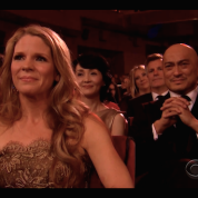 The King and I's Kelli O'Hara and Ken Watanabe watch as their co-star Ruthie Ann Miles gives her acceptance speech for the Tony Award for Best Featured Actress in a Musical at the 69th Annual Tony Awards at Radio City Music Hall in New York on June 7, 2015.