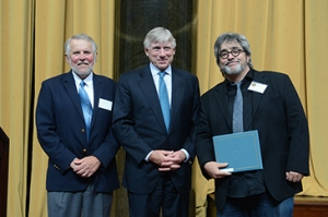 Mike Pride, Pulitzer Prize Administrator (left) and Lee C. Bollinger, President of Columbia University (center), present the 2015 Drama Prize to Stephen Adly Guirgis on Thursday, May 28, 2015, at a luncheon ceremony at Low Library on the Columbia University campus in New York City. Photos by Eileen Barroso and Jake Young