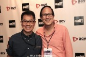 Media arts critic and scholar PETER FANG with filmmaker/author Arthur Dong at the Forbidden City, USA screening and conversation at Cinema Village East at the Asian American International Film Festival in New York on July 25, 2015. Photo by Lia Chang