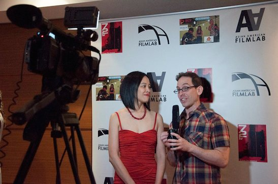 Award-winning filmmakers Lia Chang and Garth Kravits doing interviews on the Red carpet for #AAFLTV and Live at the 11th Annual 72 Hour Shootout Red Carpet Awards Ceremony and wrap party at The Azure in New York on July 25, 2015. Photo courtesy of 72 Hour Shootout/Facebook