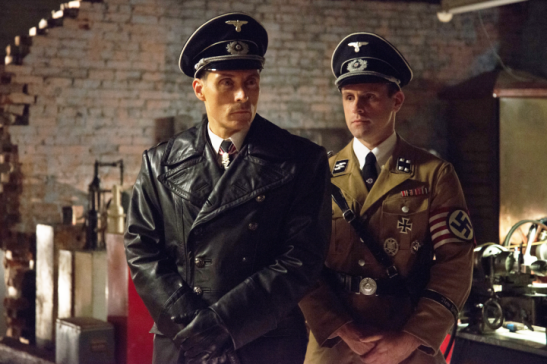 Actors Rufus Sewell and Aubrey Deeker in The Man in the High Castle. (David Berg/Amazon Studios)