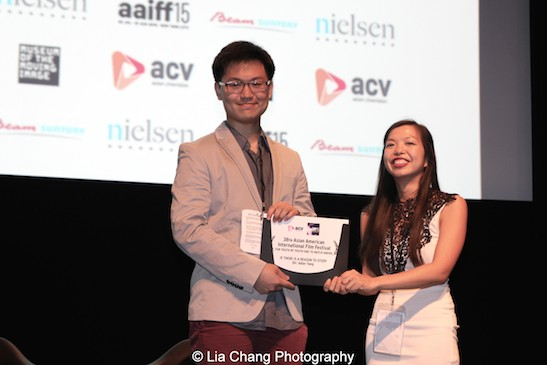 Director Adler Yang received the AAIFF 2015 For Youth By Youth One to Watch Award from AAIFF 2015 Festival Director Judy Lei for his film IF THERE IS A REASON TO STUDY at the Museum of the Moving Image in Astoria on August 1, 2015. Photo by Lia Chang