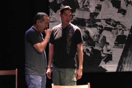 Alan Muraoka and Darren Lee discuss the choreography for a scene in rehearsal for THE REPORT. Photo by Lia Chang