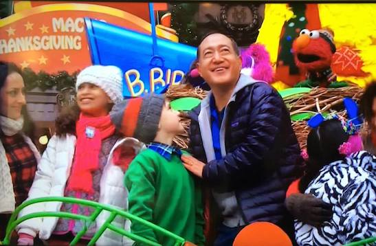 Alan Muraoka and the cast of Sesame Street in the Macy's Thanksgiving Day Parade in New York on November 27, 2014. Photo by Lia Chang