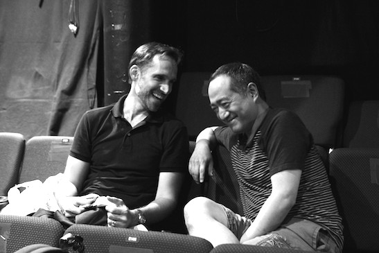 Costume designer Brian Hemesath and director Alan Muraoka in rehearsal for THE REPORT at The Lynn Redgrave Theater at the Culture Project. Photo by Lia Chang