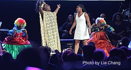 Ebony Jo-Ann as Addapearle, Darlesia Cearcy as Dorothy and the Munchkins in The Wiz is 40 at Rumsey Playfield, Summerstage in New York on August 12, 2015. Photo by Lia Chang