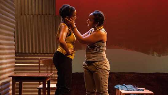 Aimé Donna Kelly (left) and Lynnette R. Freeman in InterAct Theatre Company's world-premiere production of 'The Dangerous House of Pretty Mbane,' a play it commissioned. (Photo courtesy of Kate Raines/Plate3Photography)