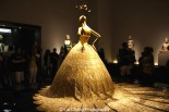 Late night at The Met- visitors packed the China: Through the Looking Glass exhibition on Saturday, September 5, 2015. The Museum closed at midnight. Guo Pei (Chinese, born 1967) Evening gown, spring/summer 2007 haute couture Gold lamé embroidered with gold and silver silk, metal, and sequins Courtesy of Guo Pei Photo by Lia Chang