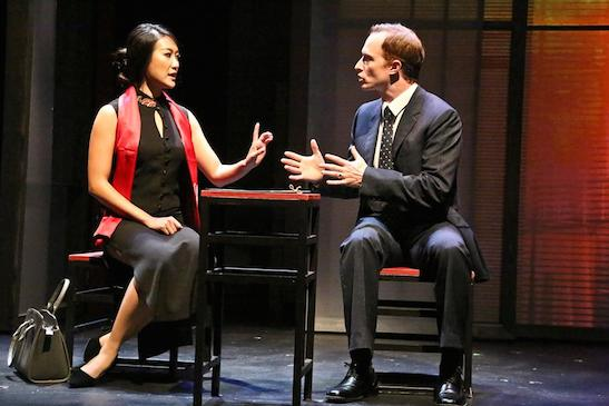 Xi Yan, Vice Minister of Culture, played by Kara Wang, explains a situation to American businessman Daniel Cavanaugh, played by Matthew Jaeger in East West Players production of David Henry Hwang's Chinglish. Photo by Michael Lamont