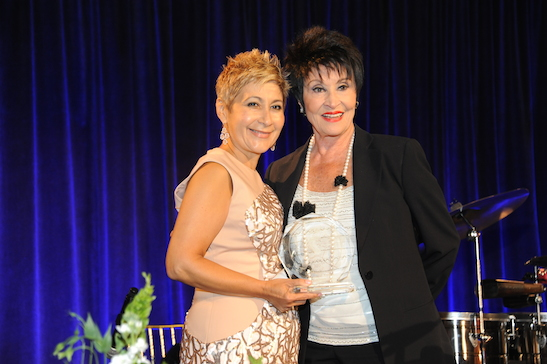 Chita Rivera (R) receives the 100 Hispanic Women National Latina Legend Award from Nancy Genova (L) Photo by Daily Photography