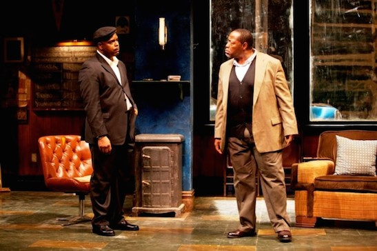 Chuck Cooper (right) as Becker, boss of the jitney station, and J. Bernard Calloway as his estranged son Booster in August Wilson's JITNEY at Two River Theater. Costumes by Karen Perry. Photo by T. Charles Erickson