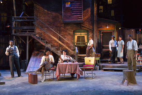 The full company of August Wilson's Seven Guitars at Two River Theater. From left: Charlie Hudson III (Red Carter), Brittany Bellizeare (Ruby), Crystal A. Dickinson (Louise), Jason Dirden (Canewell), Kevin Mambo (Floyd Barton), Christina Acosta Robinson(Vera), and Brian D. Coats (Hedley) in August Wilson's Seven Guitars at Two River Theater. Photo by T. Charles Erickson