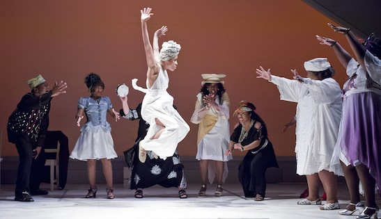 (Center) Yusha-Marie Sorzano (Ensemble) dances in Regina Taylor's 10th anniversary production of the Goodman Theatre's Crowns in 2012. Costumes by Karen Perry. Photo by Liz Larsen