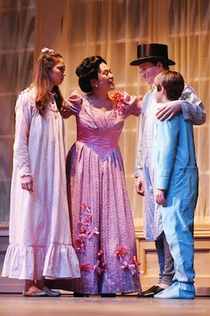 Delphi Borich (Wendy Darling), Christine Toy Johnson (Mrs. Darling), Séamus Gailor (Michael Darling) and Matthew Caraccioli (John Darling). Photo courtesy of Syracuse Stage