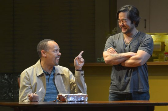 (l to r) Tyrone Mitchell Henderson (Lucien) and Tim Kang (Ray) in Julia Cho's Aubergine at Berkeley Rep. Photo courtesy of kevinberne.com