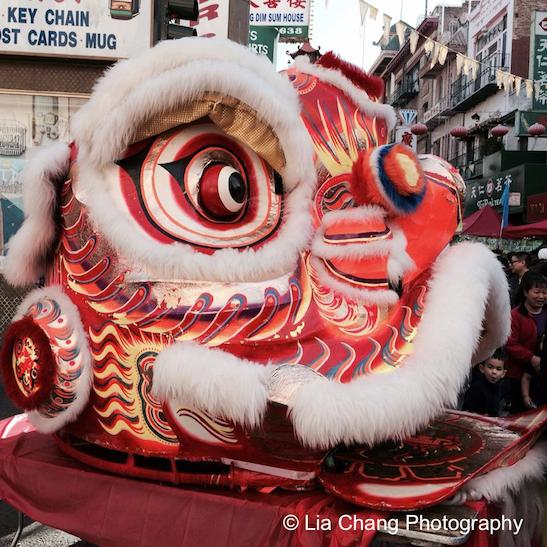 The mask of the lion is made from paper-maché and bamboo. Photo by Lia Chang