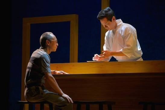 Francis Jue and James Seol in tokyo fish story. Photo by Kevin Berne